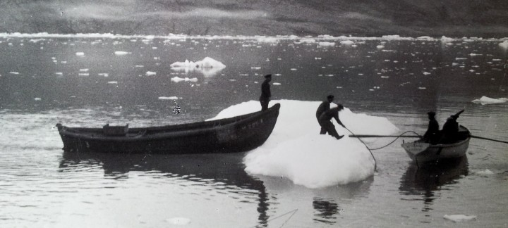 people boat iceberg photo