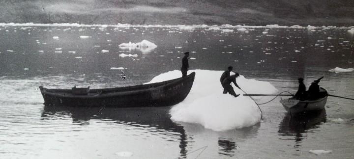 people boat iceberg photo